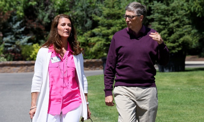 Microsoft technology advisor Bill Gates and his wife Melinda leave on the second day of the Allen and Co. media conference in Sun Valley, Idaho July 10, 2014. Photo by Reuters/Rick Wilking.