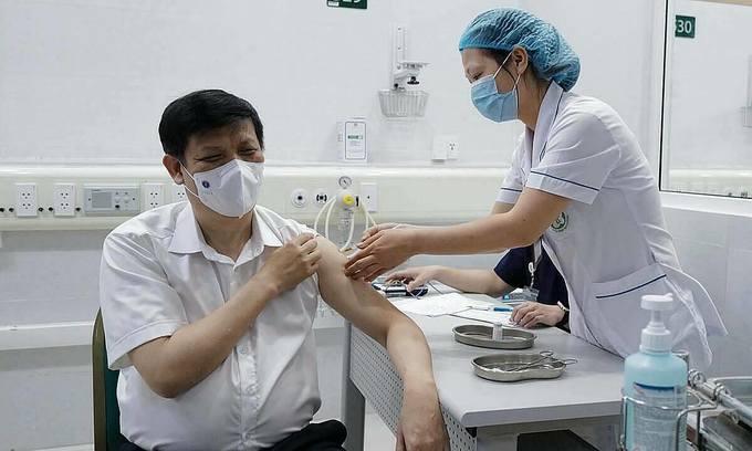Health minister Long gets AstraZeneca vaccine shot