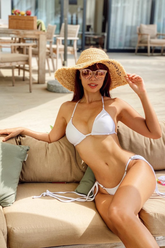 Model Ha Anh wears a white thong bikini in a vacation.