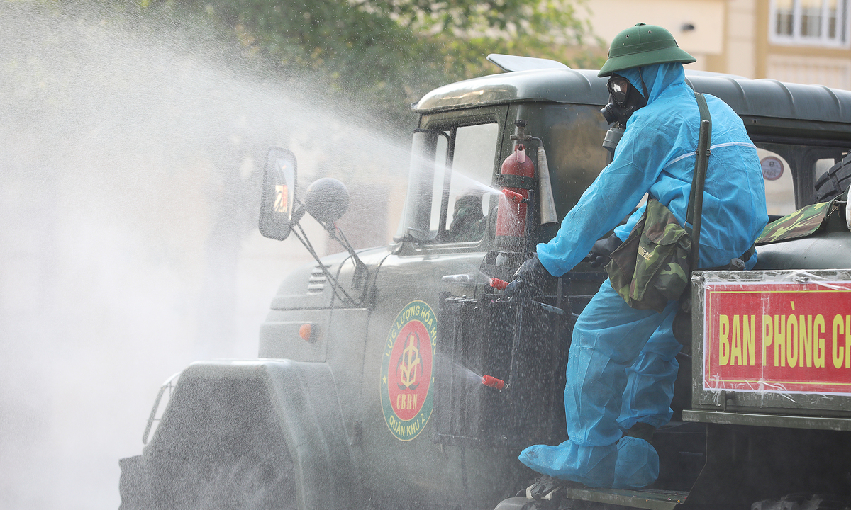 Vietnam steps up Covid-19 containment as outbreak gets bigger