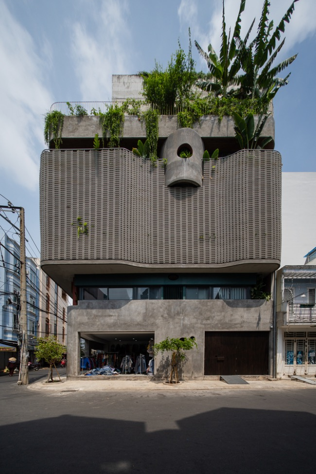 The owners wanted to have a minimalist facade, so architects decided to used cement and cemboards, a rigid, medium density, high-performance cement bonded particle building board that offers great strength and stability.Curves and plants on the facade give the house a softer look.