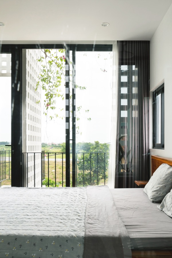 Bedroom with a green view.