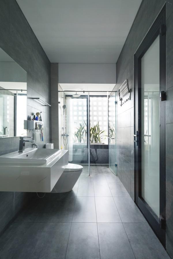 The facade allows natural light to enter the restroom.