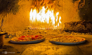 H'mong sausage pizza served hot out of oven in Sa Pa