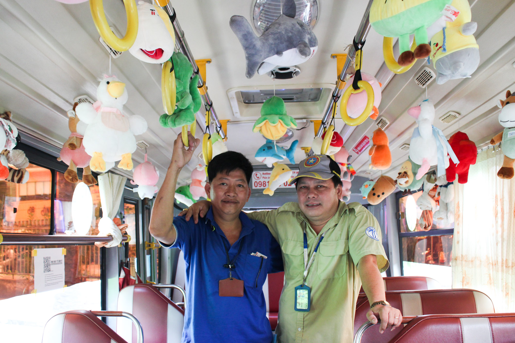 Pham Van Sang (L) and Pham Ngoc Tuyen (R) posing for photo in the Bus 146. Photo by VnExpress/Diep Phan.
