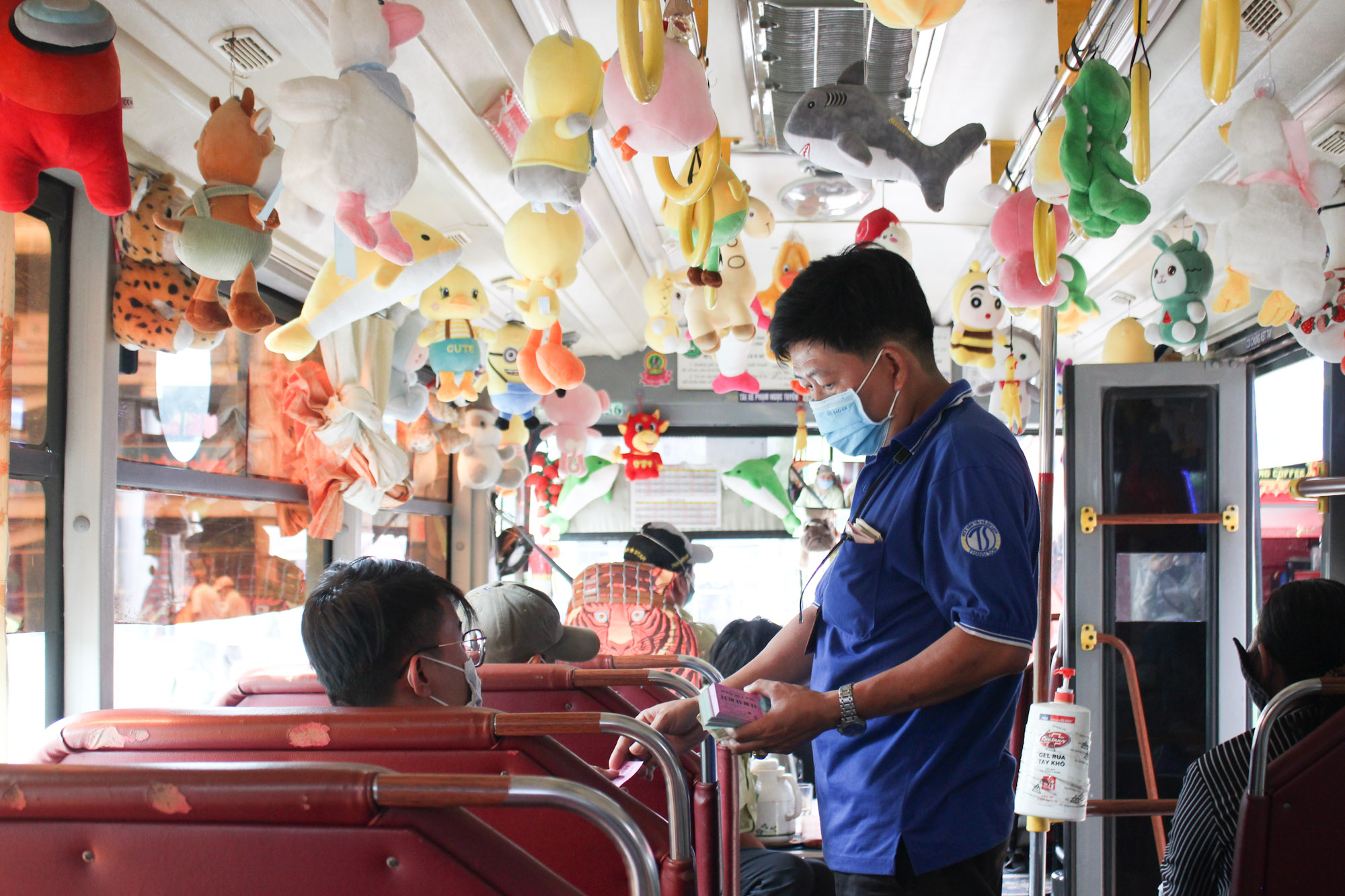 Stuff animals are dangling inside the bus. Photo by VnExpress/ Diep Phan.