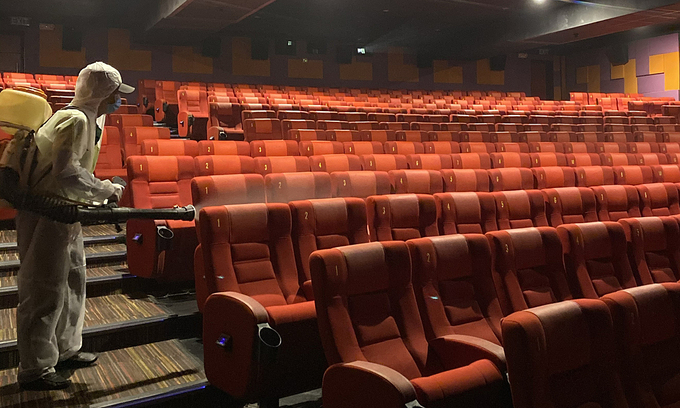 A movie theater in HCMC is disinfected for coronavirus prevention in May 2020. Photo by VnExpress/Quynh Tran.
