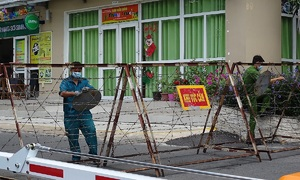 HCMC isolates apartment building as resident tests coronavirus positive
