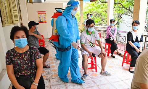 Vietnam's new Covid wave to last longer, spread further: health minister