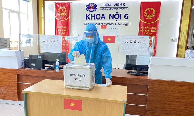 Voters discharge duty at Hanoi's locked down hospitals