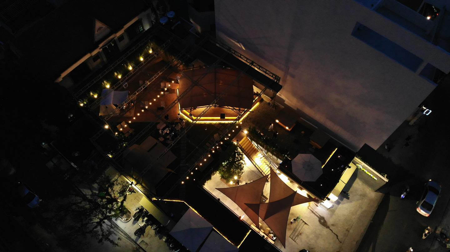 The cafe is seen from above at night.
