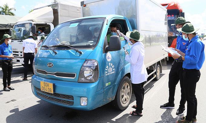 Localities impose mandatory quarantine on Covid-hit HCMC travelers
