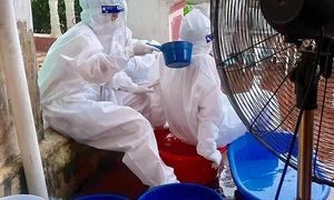 Ice bags and water offer health workers respite from sizzling heat