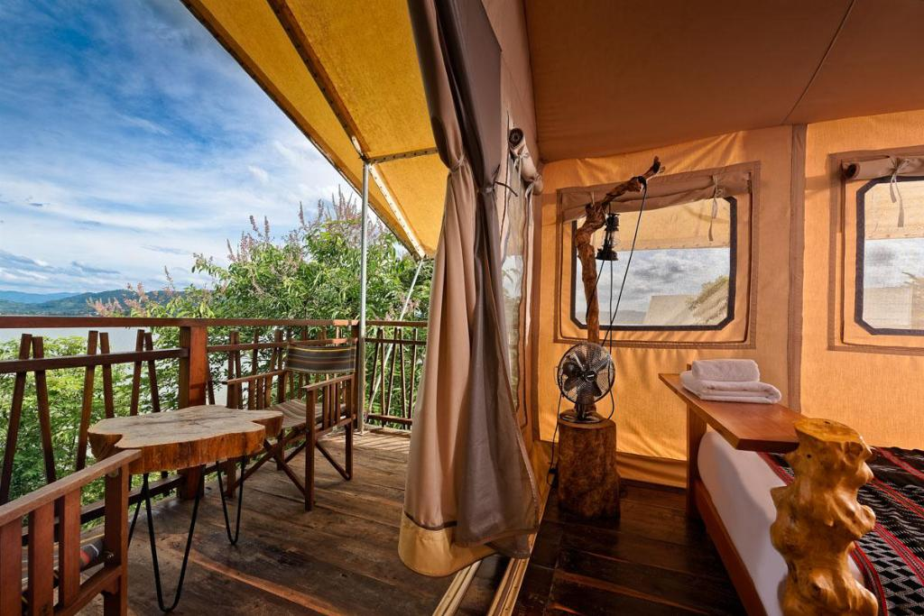 Tents are designed with modern furniture and overlooks the Lak Lake. Photo courtesy of Lak Tented Camp.