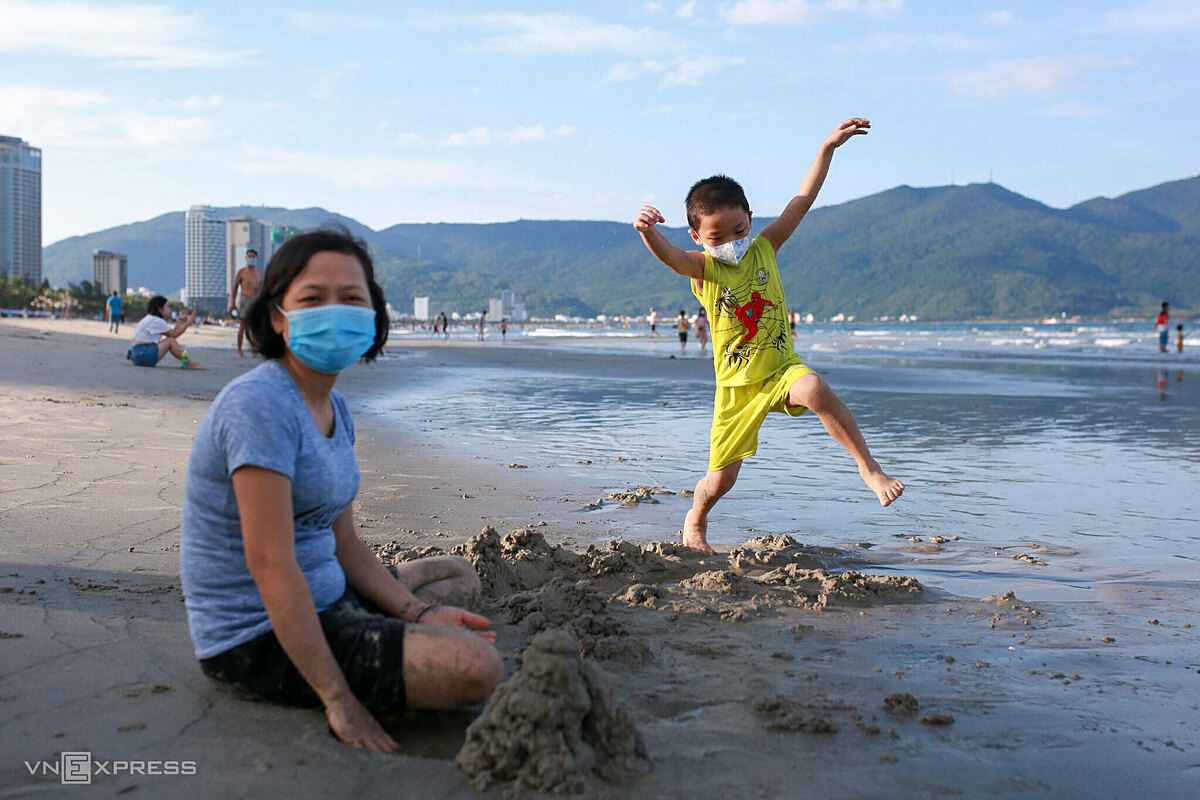 Huynh Thi Diem Trinh, 41, a teacher and her six-year-old son Vo Phuc Hung return to the beach after more than a month.My son likes swimming very much. Although the pandemic situation in Da Nang is basically under control, I am still worried so we absolutely wear masks and keep a safe distance, she said.Despite lifting swimming ban, people are only allowed to flock to beaches from 4:30 a.m. to 7:30 a.m. and 4:30 p.m. to 6:30 p.m. to reduce the risk of spread of infection. Da Nang, which recorded 158 infections during the ongoing wave, closed all beaches and suspended non-essential services on May 4.