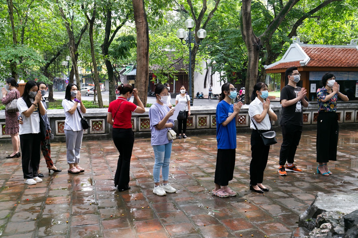At 9 a.m., But Tower and Ngoc Son Temple at Hoan Kiem Lake see a lot of people coming and pray for luck.