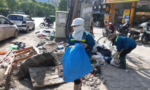 Hanoi environmental workers unpaid for months pick trash to survive