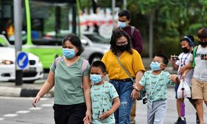Vietnamese workers in Singapore stay strong amid havoc caused by Covid