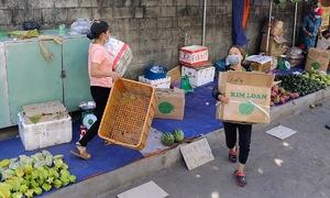 Saigon street markets shut hastily as city intensifies Covid battle
