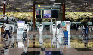 Singapore cuts stay-home period for visitors to 14 days