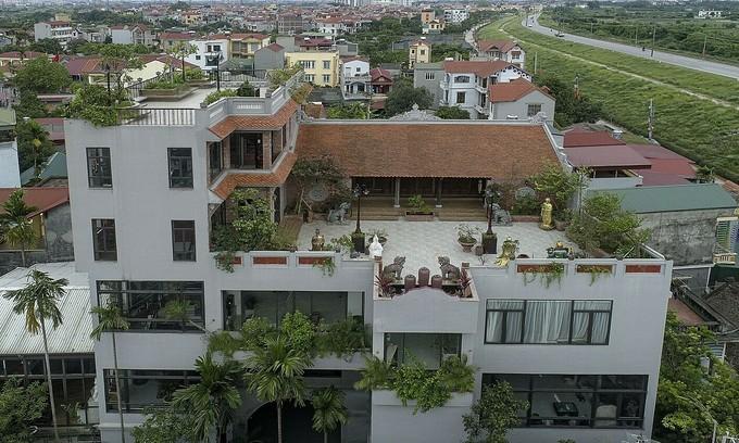 Century-old Hanoi ancestral home lifted atop villa