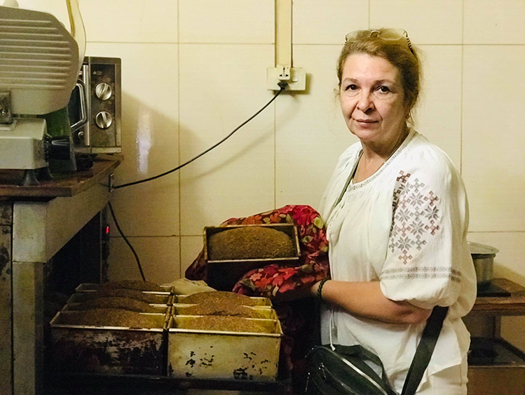Svetlana Nguyen making loaves of traditional Russian black bread, a key ingredient in her the restaurants dishes. Photo by VnExpress/Hai Hien.