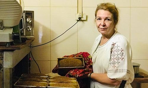 Ukrainian woman's unyielding 20-year battle to save paralyzed husband