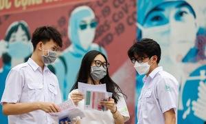 Covid spectre haunts Saigon parents as students take national exam
