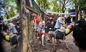 Hanoi to shut down indoor restaurants, cafes, barbershops again