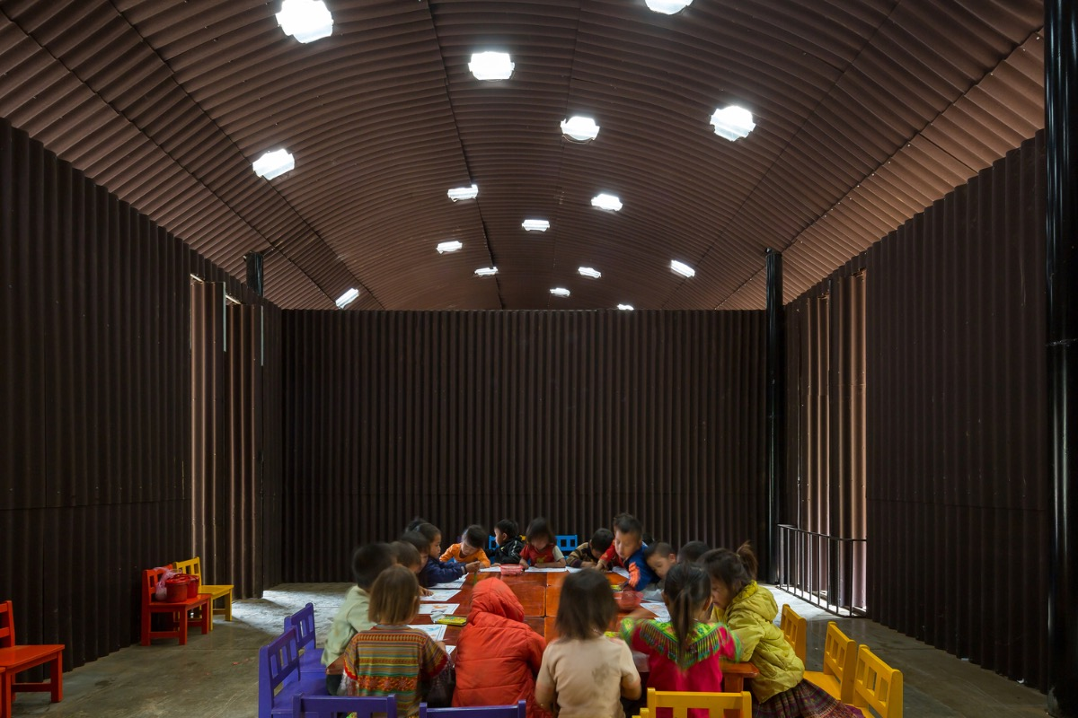 The corrugated metal construction is basic, with some sensible-looking devices to ensure ventilation and holes allowing sunlight to enter the school.