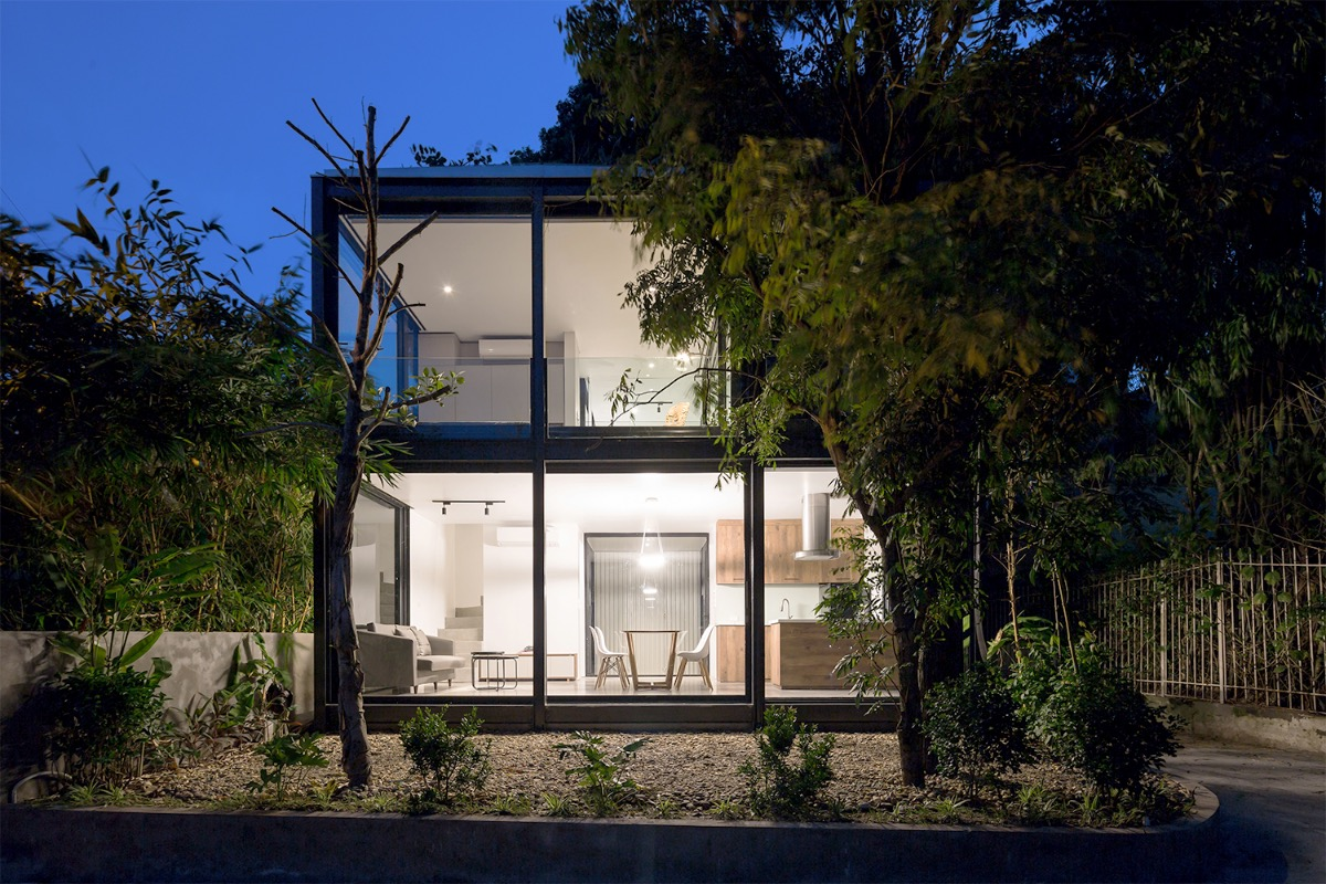 The glass doors and walls give the house a distinctive look at night.