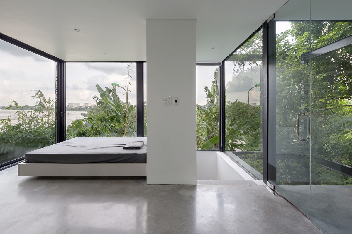 The bedroom on the first floor has a 360-degree view of the river.
