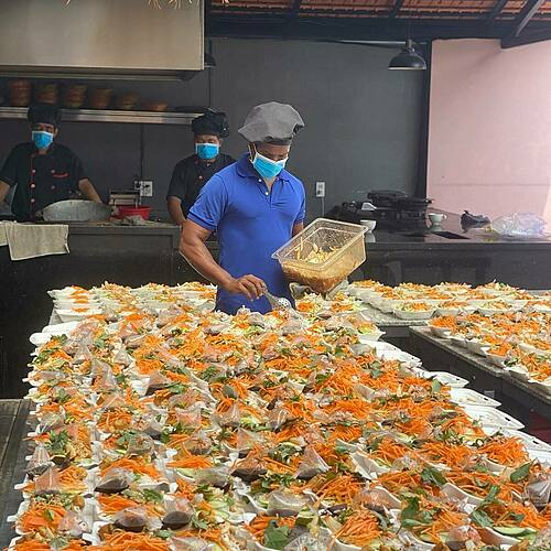 Robin Deepu prepares meals in his Indian restaurant in Saigons District 2. Photo courtesy of Robin Deepu.