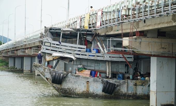 Fishing boat stuck under Vung Tau bridge
