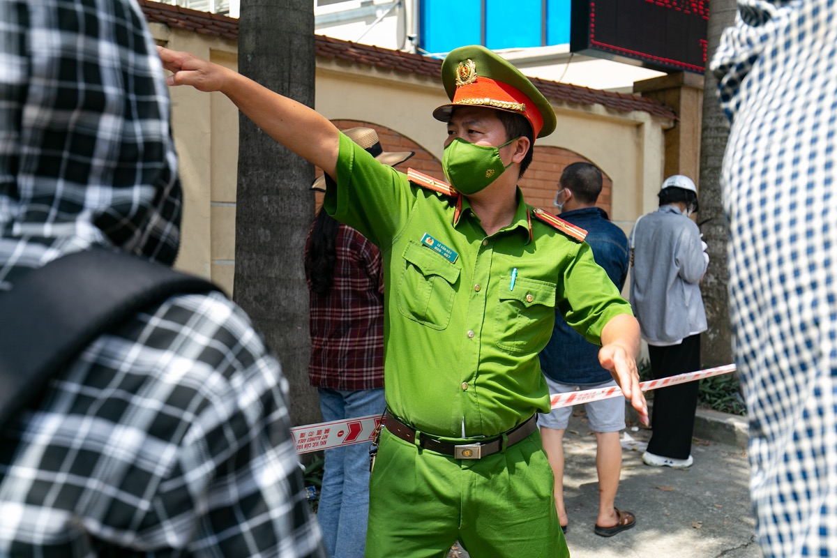 Local police tell people to follow social distancing rules.
