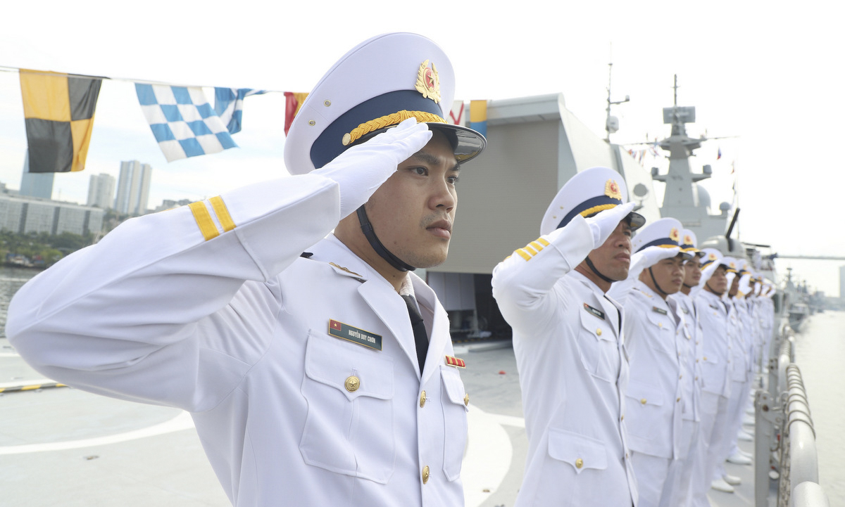 The Vietnamese crew salutes the command ship.This is the second time the Vietnam Peoples Navy has sent ships to attend the naval parade in Russia after the first time in 2019.