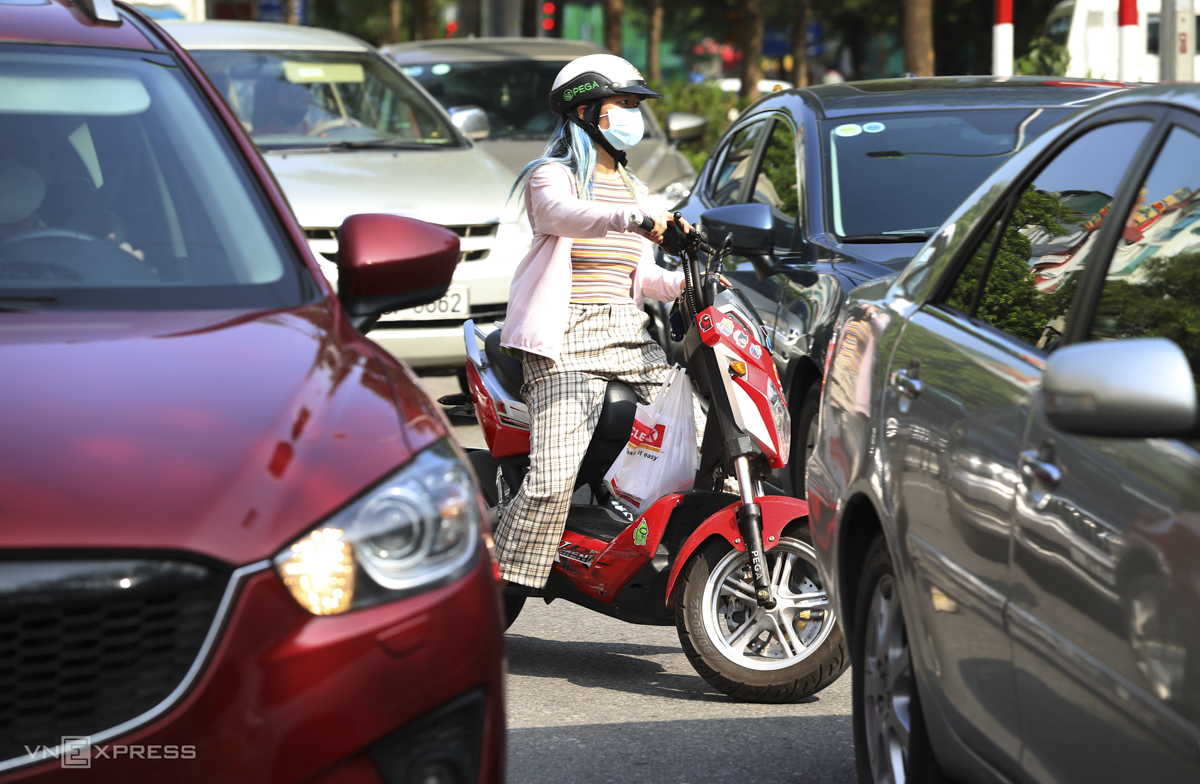 A woman turns around at a checkpoint.