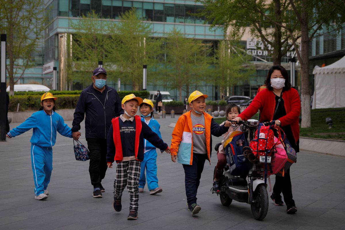 People pick up children from a school in Beijing, China, April 6, 2021. Photo by Reuters/Thomas Peter.