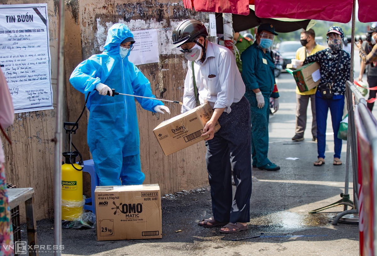 A man has his boxes sanitized by a medic.