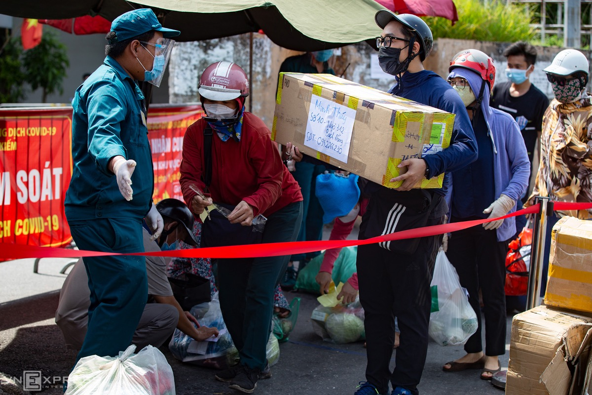 People are required to queue and have their packages sanitized before handling.