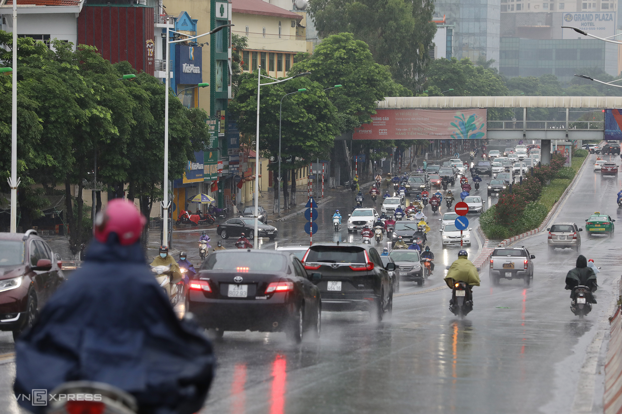 Hanoi teems with traffic despite Covid social distancing