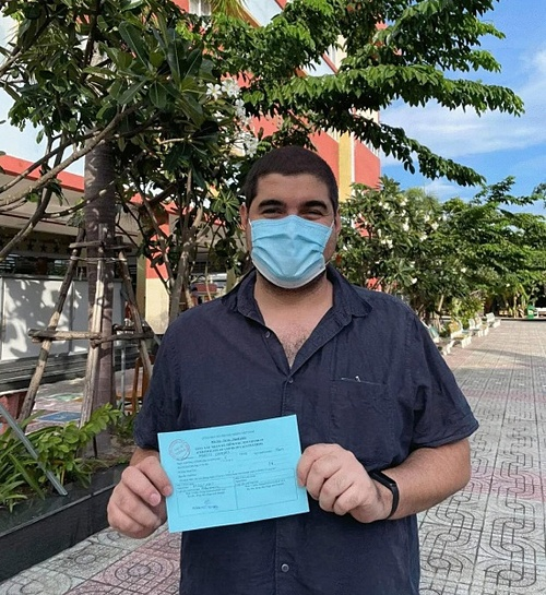 Marcos Campos has his certification after getting vaccine on August 5, District 4, HCMC. Photo courtesy of Campos