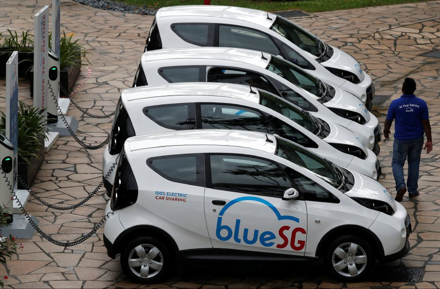 Singapores BlueSG electric car-sharing vehicles were launched in 2017. Photo by Reuters.