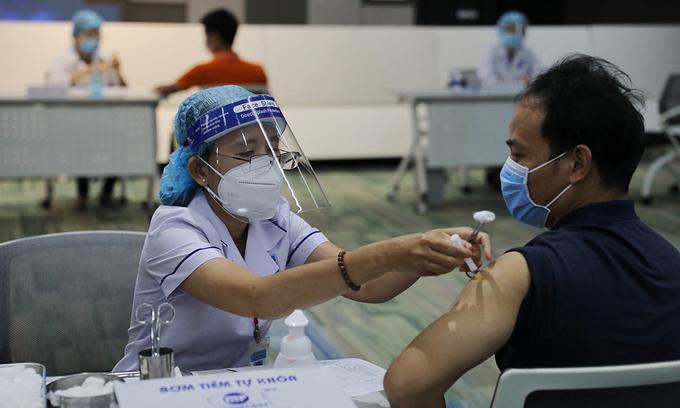 Politburo's advisory body proposes paid Covid vaccination
