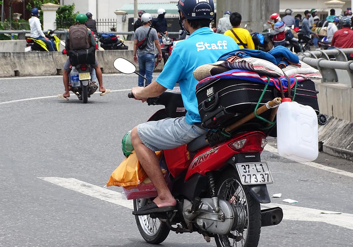 Hoang Van Trung leaves HCMC on his motorbike.