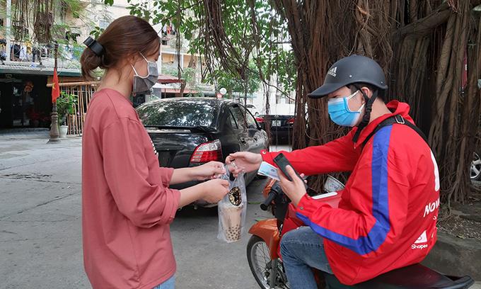 Hanoi to restrict motorbike shipper timings