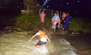 Two people washed away by floods as Storm Conson brings heavy rains