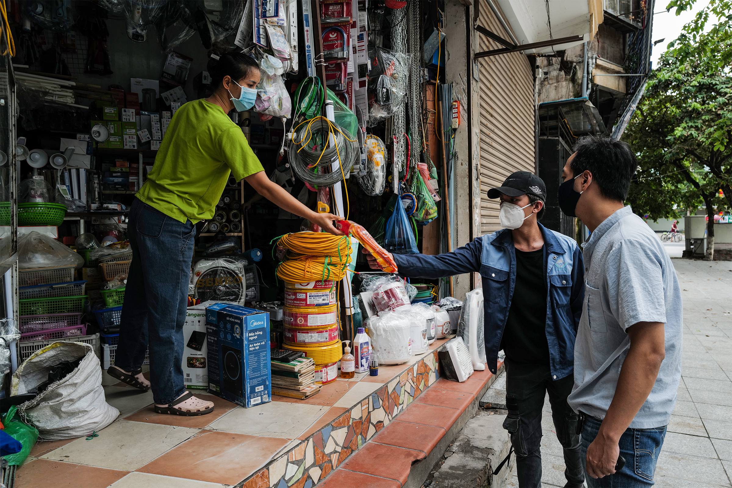 Signs of life return to Hanoi on first reopening day