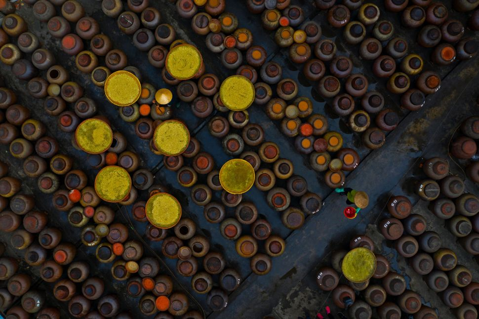 A shot taken by Azim Khan Ronnie captures the scene of people preparing materials to make traditional soy sauce in Cu Da Village, Hanoi.