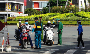 Government staff to return to work in designated timeframes: HCMC police